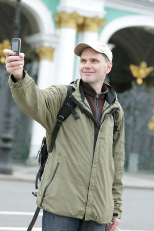 Tourist taking a picture with mobile phone in St. Petersburg photo