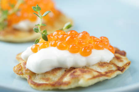 caviar: Blinis with red caviar and sour cream Stock Photo