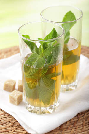 tea hot drink: Moroccan mint tea and brown sugar on the napkin