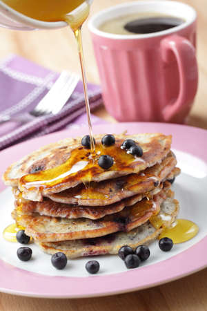 coffee berry: Stack of blueberry pancakes with honey and black coffee