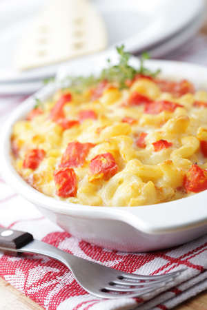 Macaroni and cheese with tomato in the baking dish Stock Photo