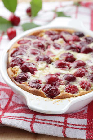 Clafoutis with sour cherry in the baking dish photo