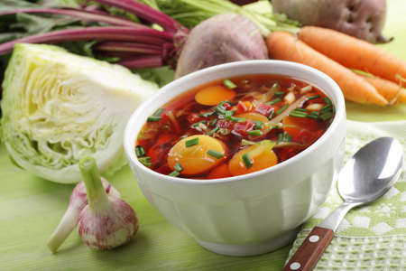 green cabbage: Russian beetroot soup with fresh vegetables on the rustic table Stock Photo
