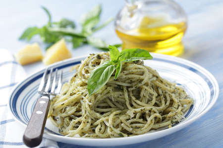Spaghetti with pesto sauce and mint closeup Stock Photo