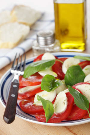 caprese: Caprese salad with mozzarella, tomato, and basil leaves Stock Photo