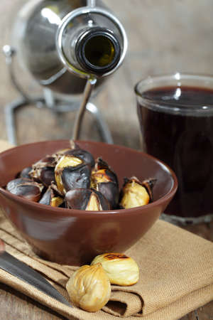 Roasted sweet chestnuts and red wine photo