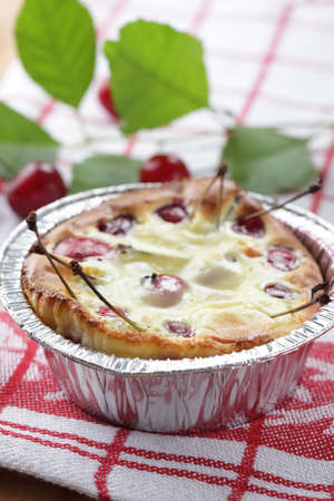 Clafoutis with sour cherry in the disposable baking dish photo