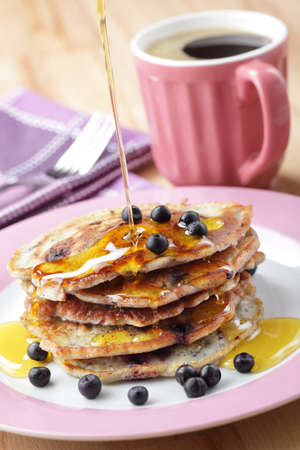 blueberry: Stack of blueberry pancakes with honey and black coffee