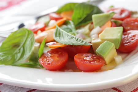 Salad with tomato, avocado, carrot and basil Stock Photo - 10082093