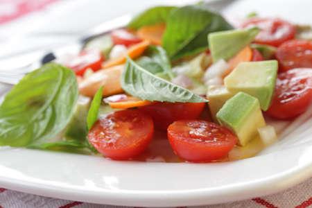 Salad with tomato, avocado, carrot and basil Stock Photo - 10082093