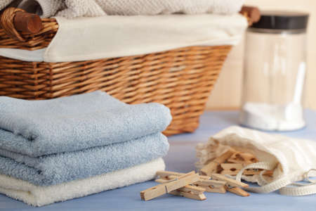detergents: Clothespins in the bag, towels, laundry detergent, and a basket