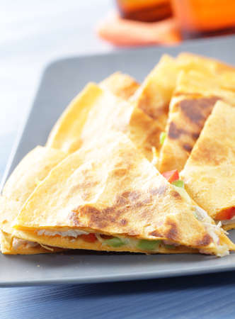 Wedges of sincronizada with chicken on the gray plate Stock Photo - 10381058