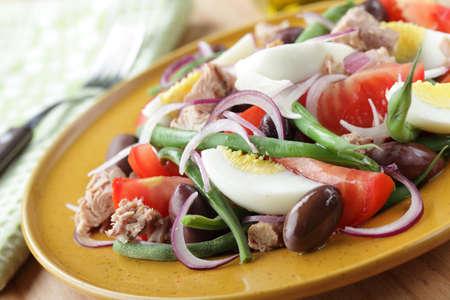 Nicoise salad with tuna and vegetables closeup photo