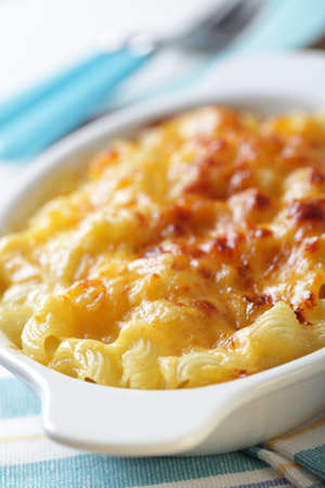 Macaroni and cheese in the white baking dish closeup Stock Photo