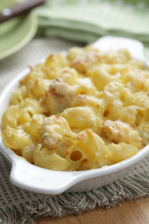 Macaroni and cheese with chicken meat closeup photo