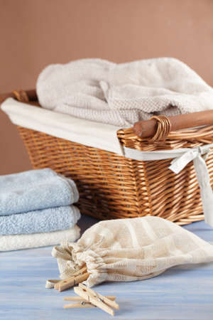 clothespins: Clothespins in the bag, towels, and a basket Stock Photo