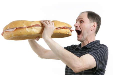 hambriento: Hombre hambriento con enorme sandwich contra blanco Foto de archivo