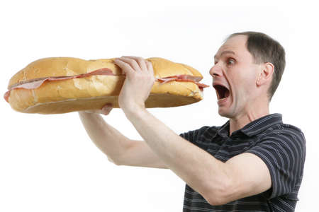 Hungry man with huge sandwich against white