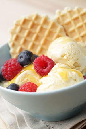 Ice cream with raspberry, blueberry, honey, and waffles Stock Photo - 10521284