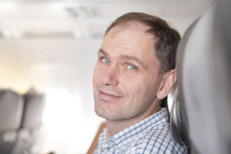 Passenger relaxing in the airplane seat Stock Photo - 10610035