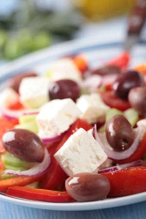 Closeup view of Greek salad on the plate closeup photo