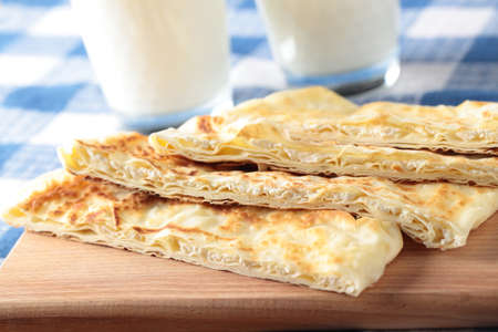 yufka: Slices of gozleme with cheese on a cutting board