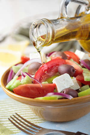salad fork: Greek salad with feta cheese and calamata olives in a bowl