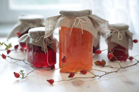 Autumn canning: jars with jam on a wooden table Stock Photo - 11004029