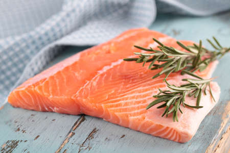 Raw salmon fillet with rosemary photo