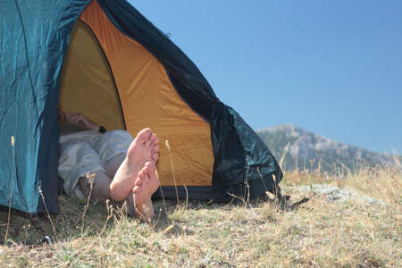 Hiker resting in a tent photo