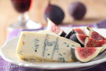 roquefort: Roquefort cheese and figs on a plate Stock Photo