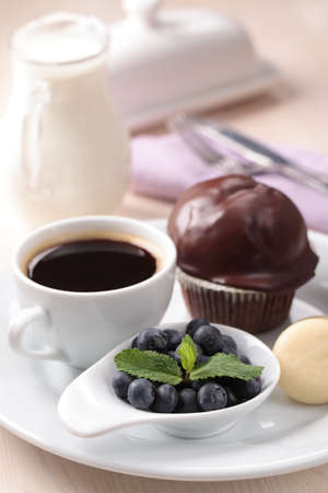 Breakfast with fresh blueberry, chocolate muffin, cheese and coffee photo