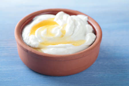 Greek yogurt with honey in a pot