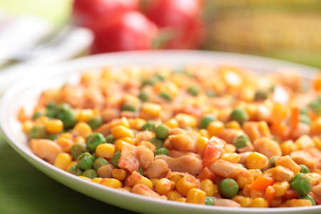 Succotash on a plate closeup. Shallow DOF photo