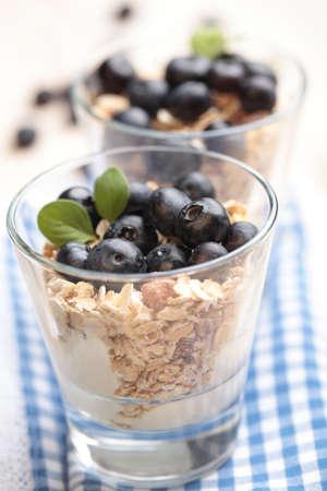Muesli with Greek yogurt and blueberry in a glass photo