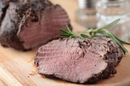sliced  �  �  �  �: Slices of roast beef closeup Stock Photo