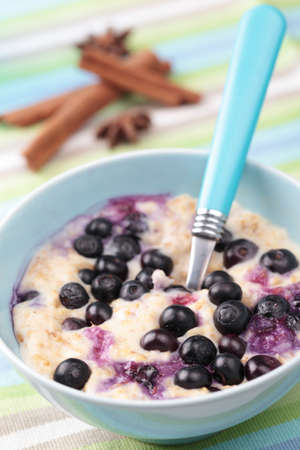 Oatmeal porridge with blueberry and cinnamon photo