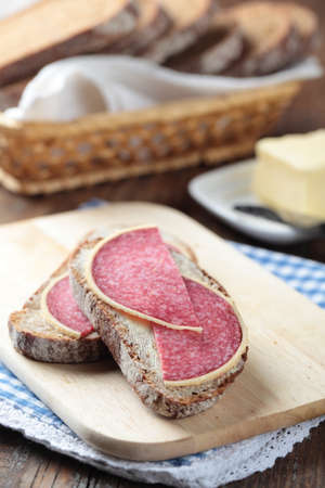 Open sandwiches with Parmesan salami and butter photo