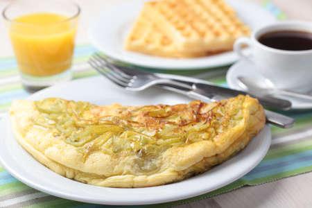 Breakfast with omelet, Belgian waffles, orange juice and black coffee photo