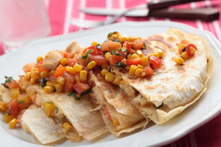 Quesadilla with chicken and vegetables on a plate photo