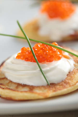 shrove: Blinis with red caviar on a plate Stock Photo