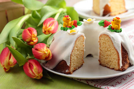 Easter cake and bunch of tulips photo