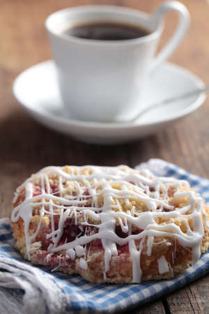 Cinnamon roll and cup of black coffee photo