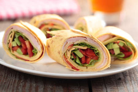 Tortilla roll-ups with ham, cheese, avocado, and pepper photo