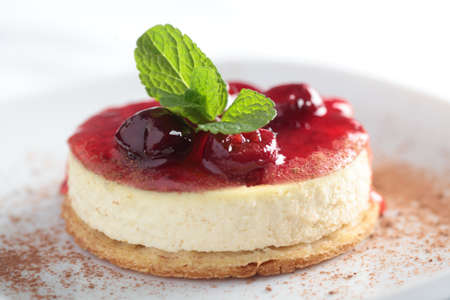 Slice of cheesecake with cherry jam photo