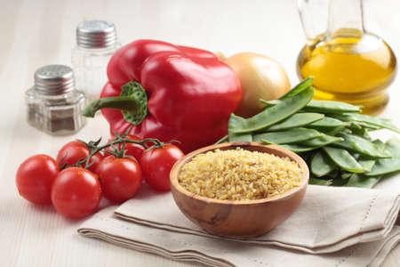 bulgur: Ingredients for bulgur pilaf on a table