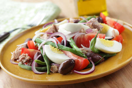 Nicoise salad with tuna and vegetables closeup photo