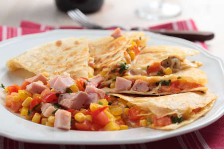 latin food: Quesadilla with ham and vegetables  Shallow DOF Stock Photo