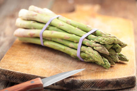 Sheaf of asparagus on a cutting board