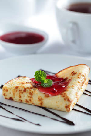 Crepe with red currant jam and mint photo